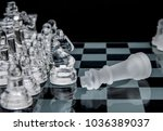 defeated king on a chessboard... | Shutterstock . vector #1036389037