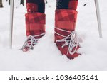 close up winter boots on snow | Shutterstock . vector #1036405141
