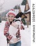 woman embracing her dog outdoor. | Shutterstock . vector #1036407979