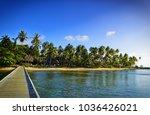 wooden pier going towards...   Shutterstock . vector #1036426021