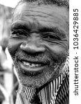 calulo  angola   2012  old men... | Shutterstock . vector #1036429885