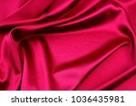closeup of ripples in red silk... | Shutterstock . vector #1036435981