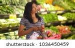 attractive black female holding ... | Shutterstock . vector #1036450459