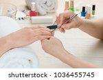 beautician using a cuticle...   Shutterstock . vector #1036455745