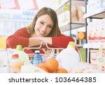 happy woman doing grocery... | Shutterstock . vector #1036464385
