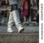 very stylish boots of a woman... | Shutterstock . vector #1036491835