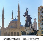 martyr statue in front of the... | Shutterstock . vector #1036496395