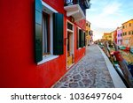 colorful house in burano island ... | Shutterstock . vector #1036497604