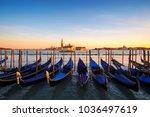 venice with famous gondolas  in ... | Shutterstock . vector #1036497619