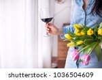 a woman with a glass of red... | Shutterstock . vector #1036504609