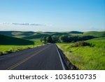 highway among wheat fields in... | Shutterstock . vector #1036510735