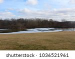the partly frozen lake in the... | Shutterstock . vector #1036521961
