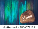 """words  """"hope"""" painted on river... 