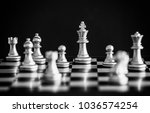 the king in battle chess game... | Shutterstock . vector #1036574254