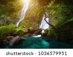 backpacker sit in waterfall ... | Shutterstock . vector #1036579951