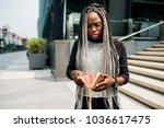 african descent checking her...   Shutterstock . vector #1036617475