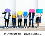 young adult friends holding up... | Shutterstock . vector #1036620589