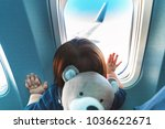 little toddler boy looking out... | Shutterstock . vector #1036622671