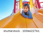 mixed race toddler boy playing... | Shutterstock . vector #1036622761