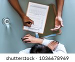 aerial view of doctor writing... | Shutterstock . vector #1036678969