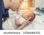 a father and his newborn on the ... | Shutterstock . vector #1036686331