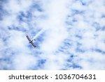 an airplane emitting white... | Shutterstock . vector #1036704631