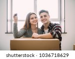 young couple sit on the floor... | Shutterstock . vector #1036718629