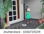 happy housewife cleaning the... | Shutterstock . vector #1036725235