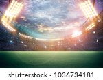 stadium in lights and flashes... | Shutterstock . vector #1036734181