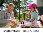 father helping his daughter in... | Shutterstock . vector #1036778851