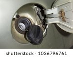 Small photo of fuel tank. fuel tank cap and rear side of flipped metal lid