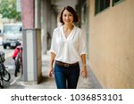 a young chinese asian woman... | Shutterstock . vector #1036853101