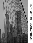 Small photo of look at the wtc through ropes of the broolyn bridge
