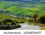 empty road and green hill in... | Shutterstock . vector #1036854637
