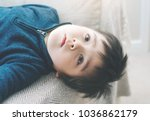 active kid laying upside down... | Shutterstock . vector #1036862179