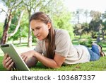 young woman with a tablet... | Shutterstock . vector #103687337