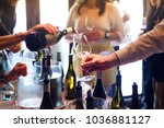 the waitress was pouring a... | Shutterstock . vector #1036881127