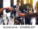 the waitress was pouring a... | Shutterstock . vector #1036881205