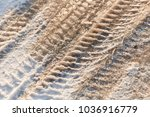 tire tracks in the frozen snow  ... | Shutterstock . vector #1036916779