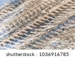 tire tracks in the frozen snow  ... | Shutterstock . vector #1036916785