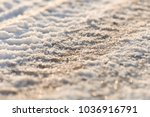 tire tracks in the frozen snow  ... | Shutterstock . vector #1036916791