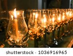 candle light on a religious day | Shutterstock . vector #1036916965