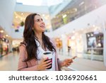 woman using mobile phone in... | Shutterstock . vector #1036920661