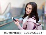 woman on escalator   Shutterstock . vector #1036921375
