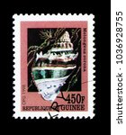 Small photo of MOSCOW, RUSSIA - NOVEMBER 26, 2017: A stamp printed in Guinea shows Florida Crown Conch (Melongena corona), Sea snails serie, circa 1998