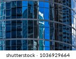 reflections on glass buildings. | Shutterstock . vector #1036929664