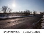 holes and pothole on a rural... | Shutterstock . vector #1036936801