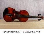 the violin lies horizontally on ... | Shutterstock . vector #1036953745