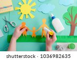 kid is gluing paper shape on a... | Shutterstock . vector #1036982635