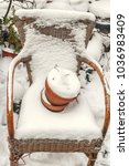 Wicker Chair Covered With Snow...